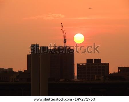Landscape of urban sunset - stock photo