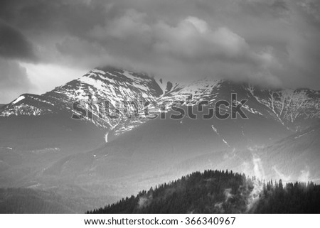 Landscape of winter mountains.View of the snow-capped peaks. Black and white picture.  - stock photo