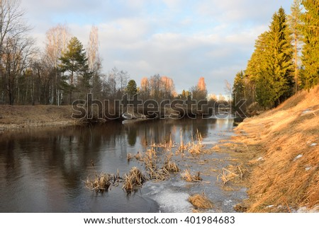 Landscape on the banks of the river Oredezh in the spring on a Sunny day in the village of Vyritsa of the Leningrad region - stock photo