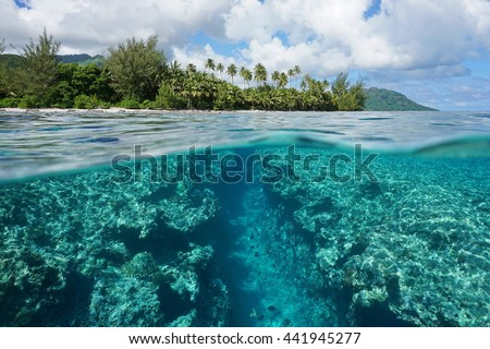 Landscape over and under water surface, tropical island shore with natural trench into the fore reef split by waterline, Huahine, Pacific ocean, French Polynesia - stock photo