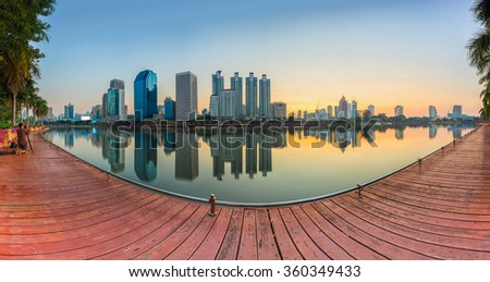 Landscape panorama skyscraper business district at dawn sky, beautiful water reflection. - stock photo