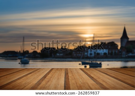 Landscape peaceful harbor at sunset with yachts in low tide with wooden planks floor - stock photo