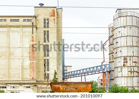 Landscape photo of an abandoned grain silo - stock photo