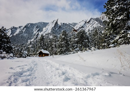 landscape photo of flat irons in boulder colorado with focus on the shack in the foreground - stock photo