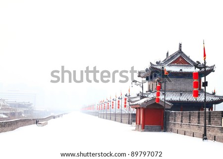 Landscape photo of traditional ancient Chinese style building with red lantern in snow - stock photo
