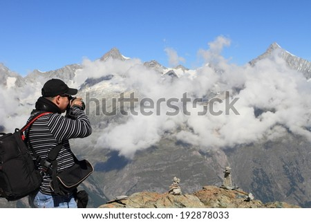 landscape photographer on the alps - stock photo