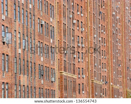 Landscape red brick facade in NYC for background use - stock photo