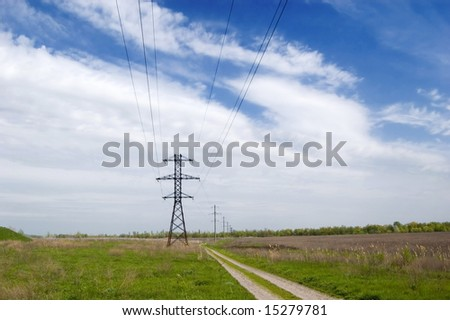 Landscape: road,  field, clouds and electric column - stock photo