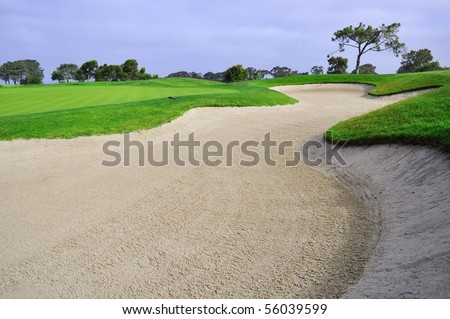 Landscape shot of Golf course with large sand trap. - stock photo