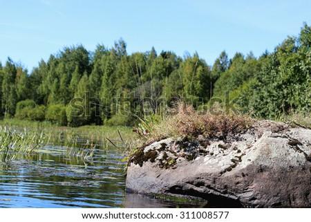 landscape stone on the lake - stock photo