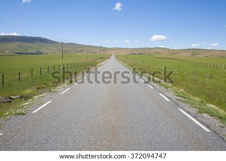 landscape straight rural grey lonely road in countryside of Spain Europe - stock photo