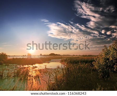 Landscape, sunny dawn at the river - stock photo