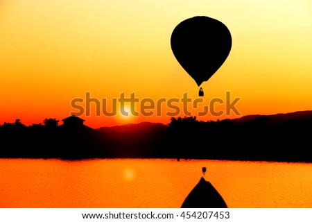 Landscape - sunset and balloon  silhouette environment on the lake  - stock photo