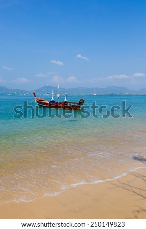 landscape the sea, the boat in a bay of  a chalong in phuket - stock photo