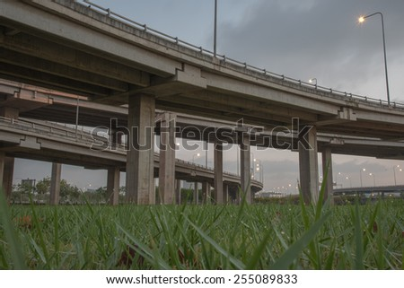 landscape tollway express road with grass lawn in night scene - stock photo