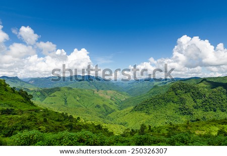 landscape view of green mountains and blue sky with clouds at laos - stock photo