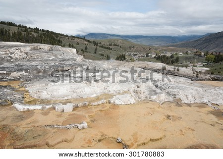 Landscape view of Mammoth Spring and rock formations in Yellowstone National Park, Wyoming - stock photo