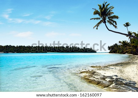 Landscape view of One foot Island in Aitutaki Lagoon Cook Islands. - stock photo