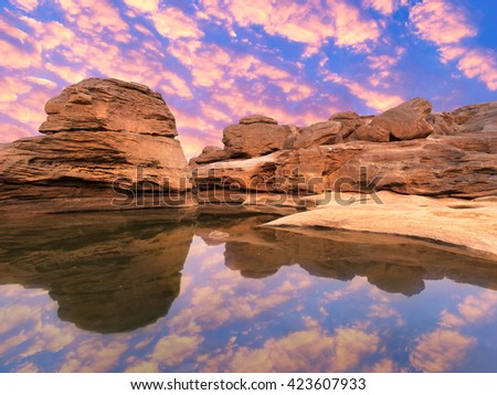 Landscape view of Sand dunes and rock field with water reflection in grand canyon - stock photo