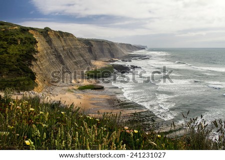 Landscape view of the beautiful rocky beach of Magoito, located in Sintra, Portugal. - stock photo