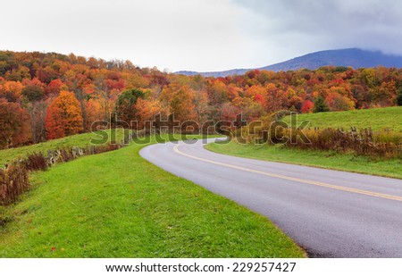 Landscape view of the Blue Ridge Parkway near Blowing Rock, North Carolina in autumn as the leaves change color in the mountains. - stock photo