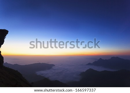 Landscape view on top of mountain and starscape - stock photo