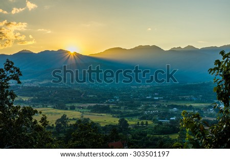 Landscape view with sunset and mountain range in Pai district, Mae Hong Son province, Northern Thailand - stock photo