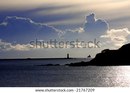landscape with a lighthouse with clouds of the big storm - stock photo