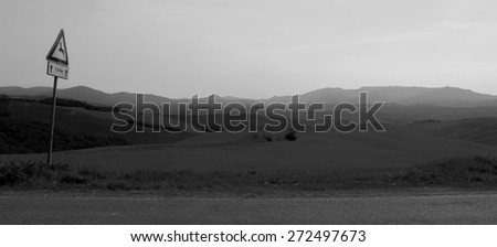 Landscape with a signpost for wild animal in Tuscany, Italy - stock photo