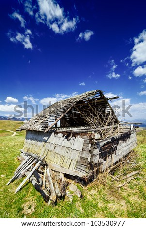 Landscape with an abandoned wooden shack - stock photo
