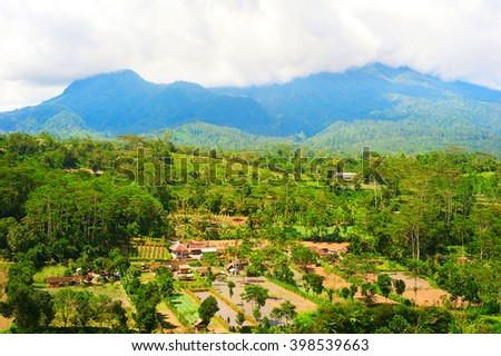 Landscape with Balinese village and mountains. Bali island, Indonesia - stock photo