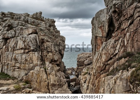 Landscape with Beach and Stones at the pink Granite Coast in the Departement Cotes d Armor in Brittany France - stock photo