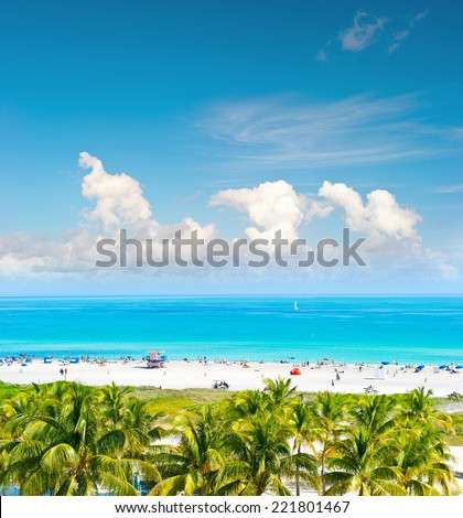 Landscape with blue sky, turquoise water and palm trees. Public beach in Miami Beach, Ocean Drive. Panoramic view - stock photo