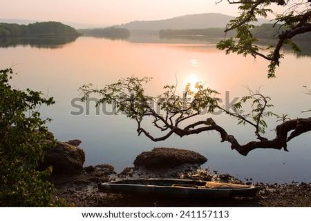 Landscape with fishing boat.India - stock photo