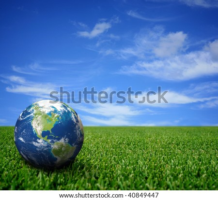 Landscape with globe - stock photo