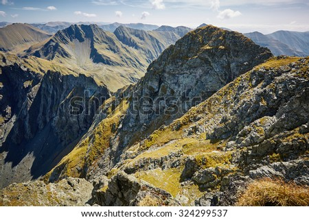 Landscape with high mountains in the summer - stock photo