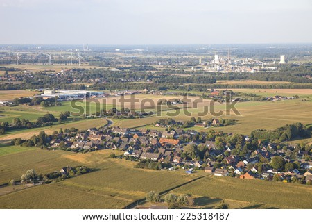Landscape with homes, industry and agriculture in the Lower Rhine Region of Germany - Aerial view of Kamp-Lintfort, North Rhine-Westfalia, Germany, Europe - stock photo