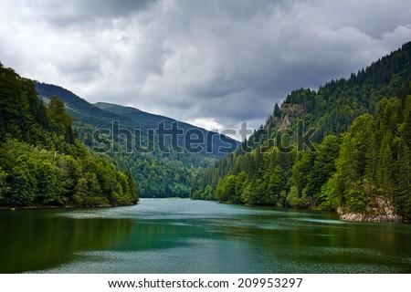 Landscape with lake Petrimanu in Romanian Parang mountains - stock photo