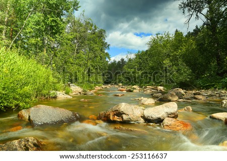 landscape with mountain river flowing over rocks at summer - long exposure  - stock photo