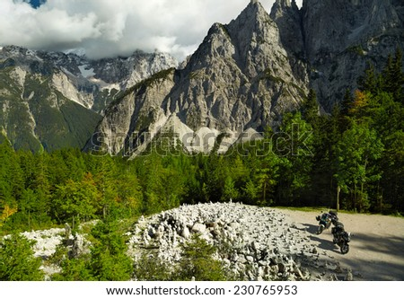 Landscape with mountains and two motorbikes - stock photo
