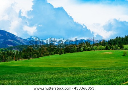 Landscape with mountains on background with beautiful sky - stock photo
