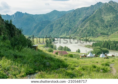 landscape with mountains trees and a river  in summer - stock photo