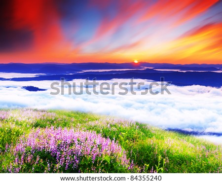Landscape with mountains under morning sky with clouds - stock photo