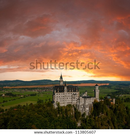Landscape with Neuschwanstein castle, majestic clouds on background - stock photo