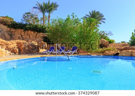 Landscape with nobody swimming pool at luxury hotel  - stock photo