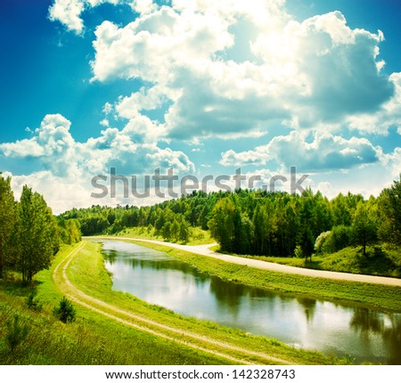 Landscape with River and Beautiful Clouds at Blue Sky - stock photo
