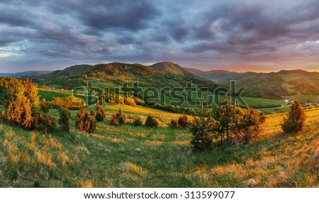 Landscape with rocky mountains at sunrise - stock photo