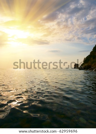 landscape with sea coast sunset - stock photo
