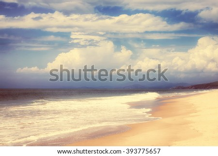 Landscape with sea, mountains and sky with clouds. HDR - stock photo