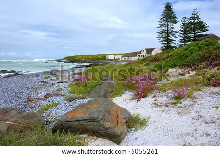 Landscape with stone and house on beautiful beach. Shot on West Coast, between Grotto Bay nature reserve and Silwerstroomstrand, Western Cape, South Africa. - stock photo